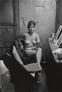11. Stripper with bare breasts sitting in her dressing room, Atlantic City, N.J. 1961.jpg