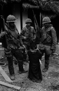 US-Soldiers-tormenting-a-civilian-in-the-old-city-of-Hue-during-the-offensive,-Tet,-Hue,-1968.jpg