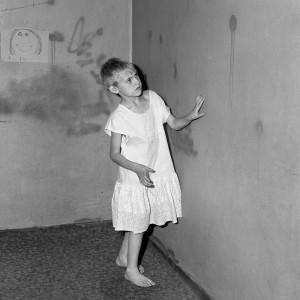 Roger Ballen, Girl in white dress, 2002.jpg