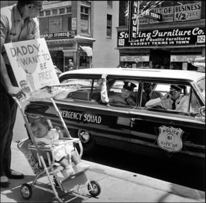 1_William Edwin Jones pushes daughter Renee Andrewnetta Jones (8 months old) during protest, Main Street, Memphis, Tennessee, 1950's (VARIANT).jpg