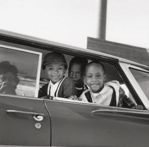 4_Michael Willis, Harry Williams, and Dwania Kyles sit in the back of a car during the first day of Memphis school integration, 1961.jpg