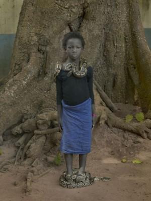 Nahaume Ouielle, 8 ans, with Daba Dre Snakes, Temple Des Pythons, Ouidah, Benin, 2011.jpg